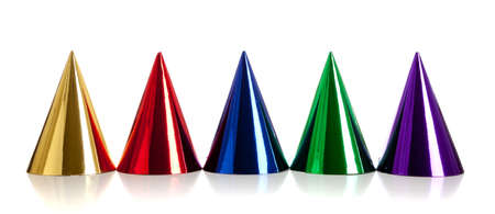 Multi-colored birthday hats, including gold, red, blue, green and purple on a white background