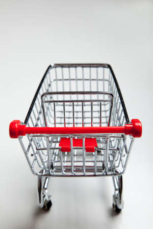 Red, metal supermarket shopping cart on a white background Stock Photo - 5876309