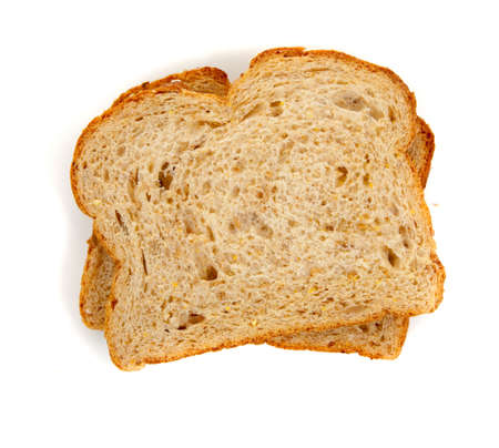 Two slices of whole grain bread on a white background