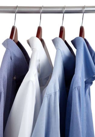 mens: Assorted blue dress hanging on wooden hangers