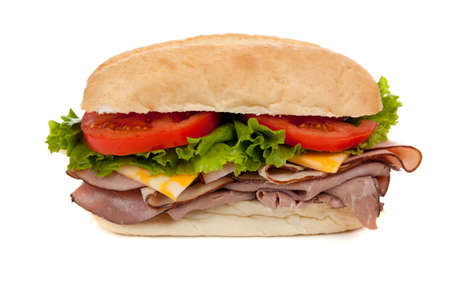 A submarine sandwich with ham, turkey, roast beef,  lettuce, tomato and swiss cheese on a white background Stock Photo