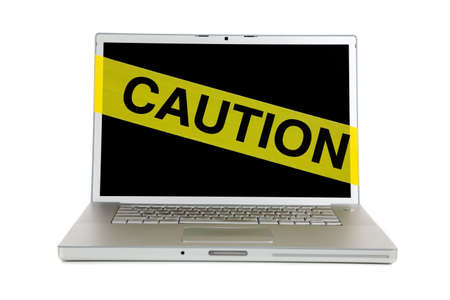 Yellow caution tape over a laptop computer screen on a white background