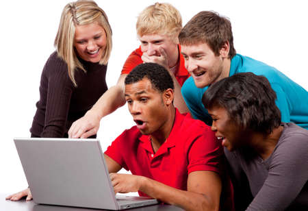 Multi-cultural college students looking at a computer screen