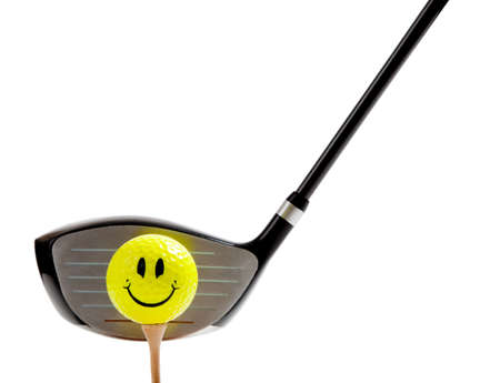 pratice: A yellow, smiley face golf ball on a ree with a driver on a white background