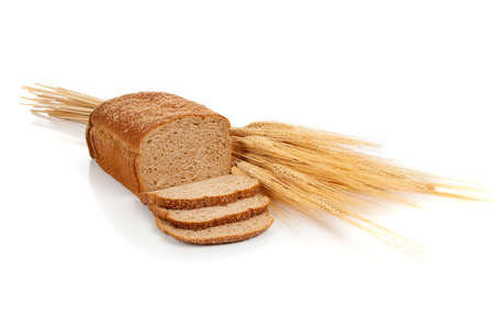 whole grains: A loaf of wheat bread and shock of wheat on a white background