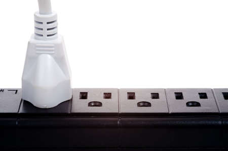 a black power strip with empty outlets on a white background