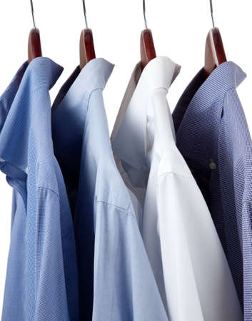Assorted blue dress hanging on wooden hangers photo