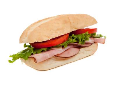A ham submarine sandwich with lettuce, tomato and swiss cheese on a white background Stock Photo - 5901015