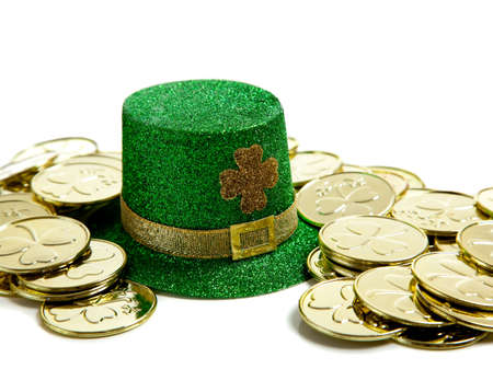 A group of St. Patricks Day decoations with a leprchaun hat and gold coins