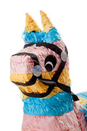 A pink, blue and yellow burro pinata on a white background photo