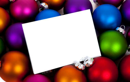 notecard: Purple, green, red, orange and blue Christmas ballsbaubles with a blank notecard Stock Photo