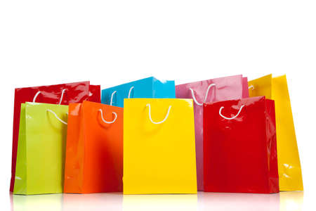 shopping bags: Assorted colored shopping bags including yellow, orange, red, pink, blue and green on a white background