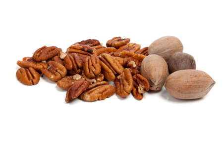 whole pecans: Shelled and whole pecans on white background Stock Photo