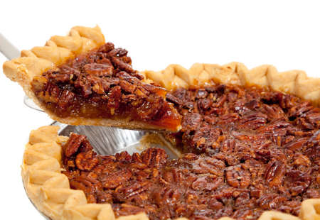 A whole pecan pie on a white background Stock Photo