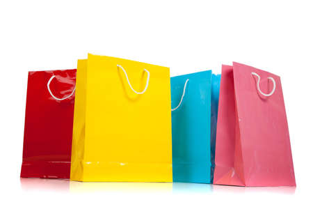 christmas shopping bag: Assorted colored shopping bags including red, yellow, blue and pink on a white background Stock Photo