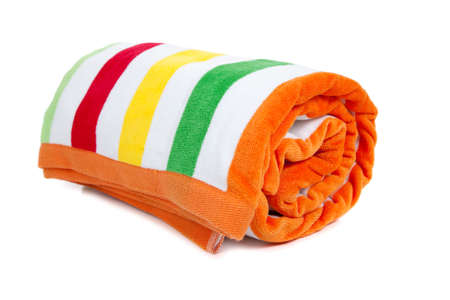 A red, white, yellow, green and orange striped beach towel on a white background