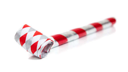 Red and silver noise makers on a white background Stock Photo - 5970825