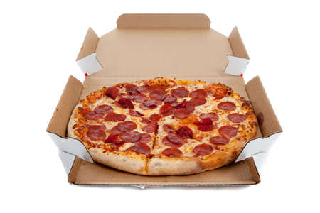 Pepperonli pizza in a box on a white background photo
