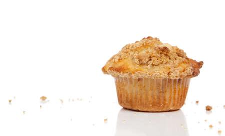 A Cinnamon struesel muffin on a cutting board