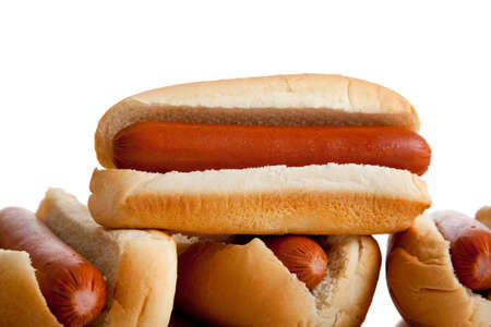 Stacked hot dogs and buns on a white background