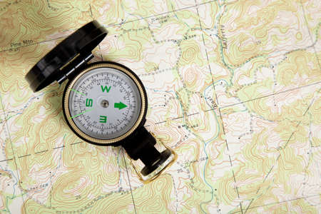 A compass on a topographical map photo