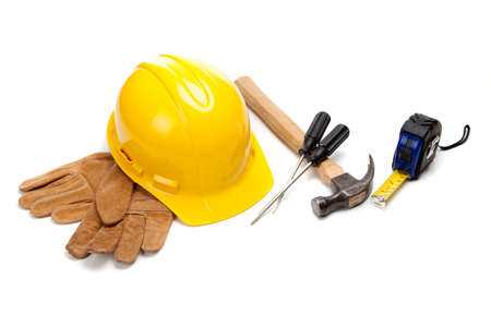 architect tools: Construction worker supplies including a yellow hard hat, tape measure, box cutter, screw drivers, hammer and work gloves on a white background