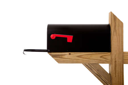 A black mailbox sitting on a wooden post on a white background Stock Photo - 5983043