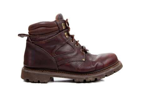 A brown leather hiking boot on a white background