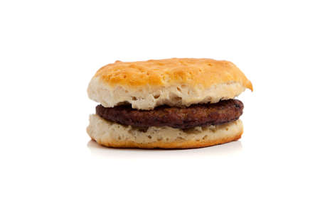 A sausage biscuit on a white background