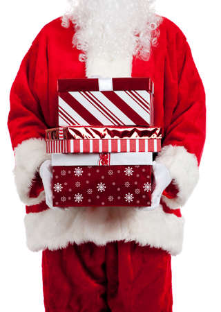 Santa Claus giving Christmas gifts wrapped in red and white on a white background photo