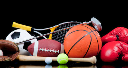 Assorted sports equipment including a basketball, soccer ball, tennis ball, golf ball, bat tennis racket, boxing gloves, football, golf and baseball glove