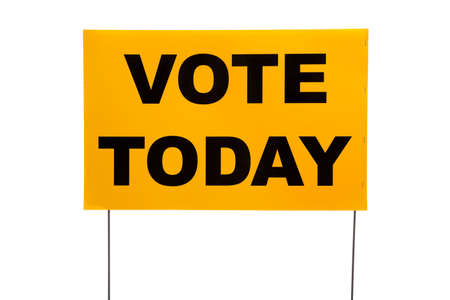 balloting: A yellow yard sign with Vote today on it on a white background