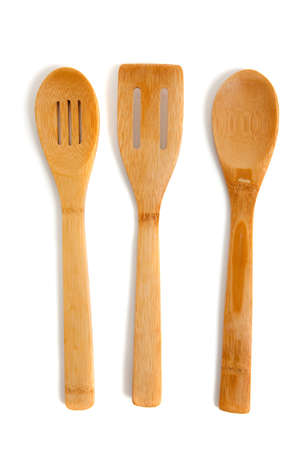 slotted: Wooden kitchern utensils including, spatula, wooden spoon and slotted spoon Stock Photo