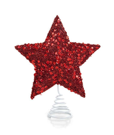 topper: a red glittery star Christmas tree topper on a white background Stock Photo