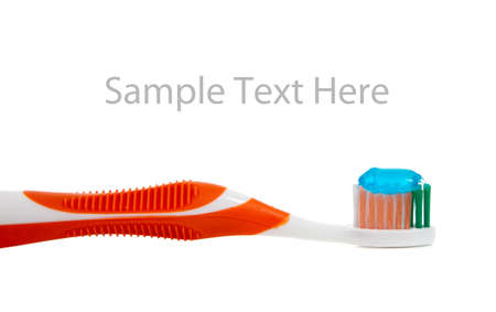 a orange toothbrush and blue gel toothpaste on a white background