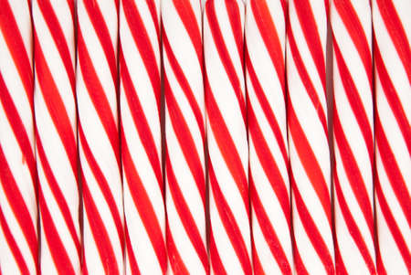 A background made of red and white striped candy canes Imagens