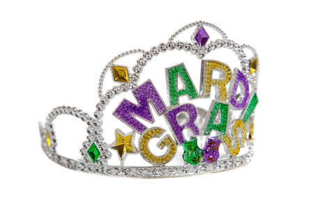 A silver, gold, purple and green mardi gras tiara on a white background Stock Photo - 6026226