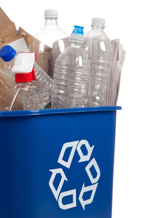 A blue recycle can with plastic bottles and paper on a white background Stock Photo - 6026221