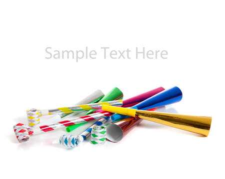 noise maker: Assorted noise makers including red, silver, yellow, green, blue on a white background with copy space