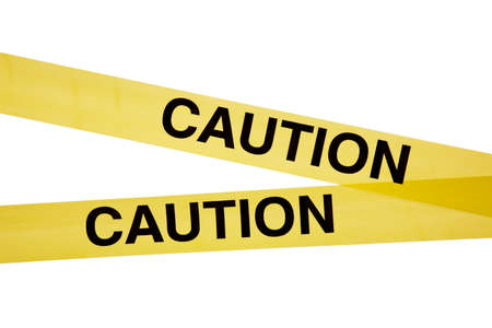 Yellow caution tape on a white background  photo