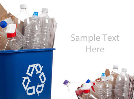 A blue recycle can with plastic bottles and paper on a white background with copy space Stock Photo - 6048119