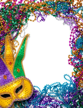 colorful beads: A border made of a gold, purple and green mardi gras mask and blue, green, red, gold and purple plastic beads Stock Photo