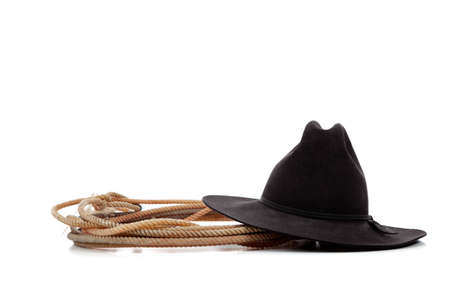 A Black cowboy hat and lasso on a white background with copy space photo