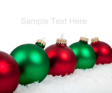 Green and red Christmas ornamentsbaubles on a white background with copy space