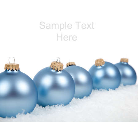 no snow: Baby blue Christmas ornamentsbaubles on a white background with copy space