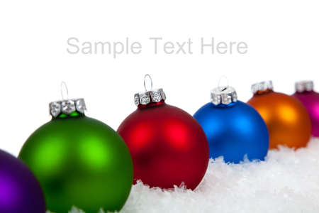 blue green background: Christmas ornamentsbaubles including purple, green, red, blue, orange and pink on a white background with copy space Stock Photo