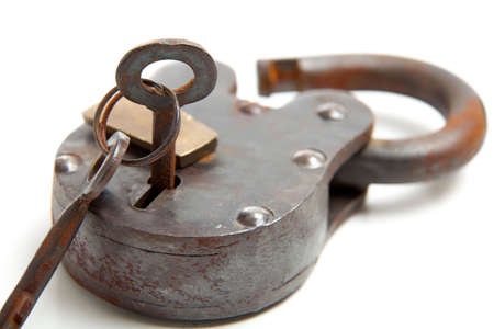 An antique lock with skeleton key on a white background
