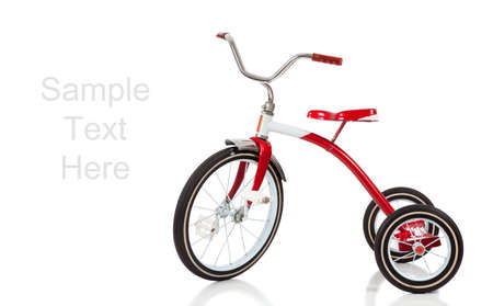 antique tricycle: A childs red tricycle on a white background with copy space