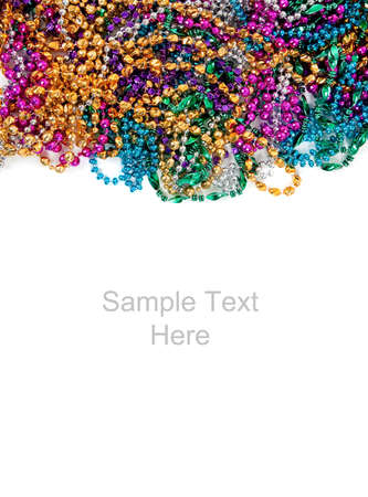 bead: Multi colored mardi gras beads including blue, green, purple, pink, yellow and gold on a white background with copy space