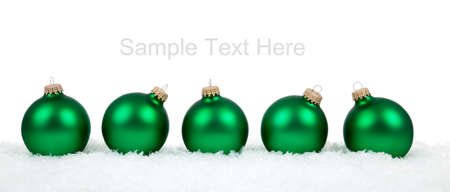 Green Christmas ornamentsbaubles on a white background with copy space Stock Photo